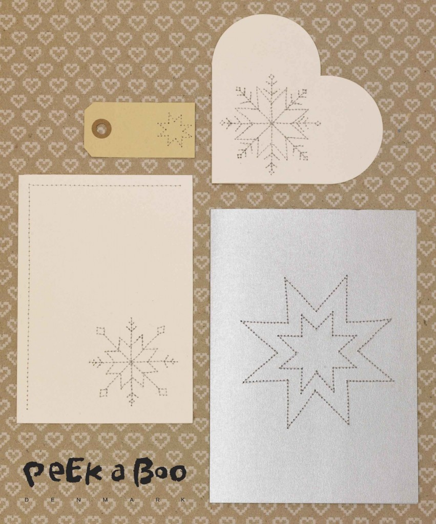 Sewn snow flakes on christmas cards by Peekaboo design