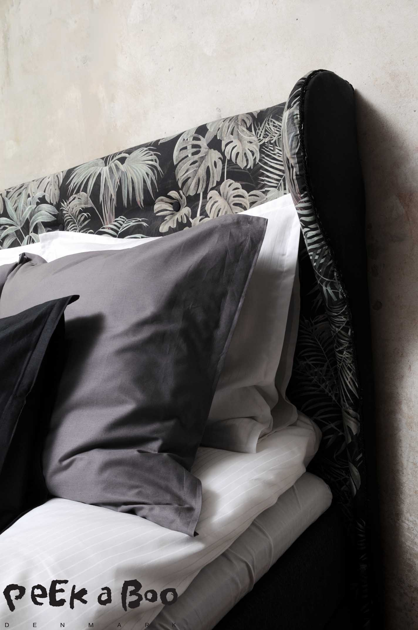 All bedlinen aer from JYSK and held in the colours white, grey and black.
