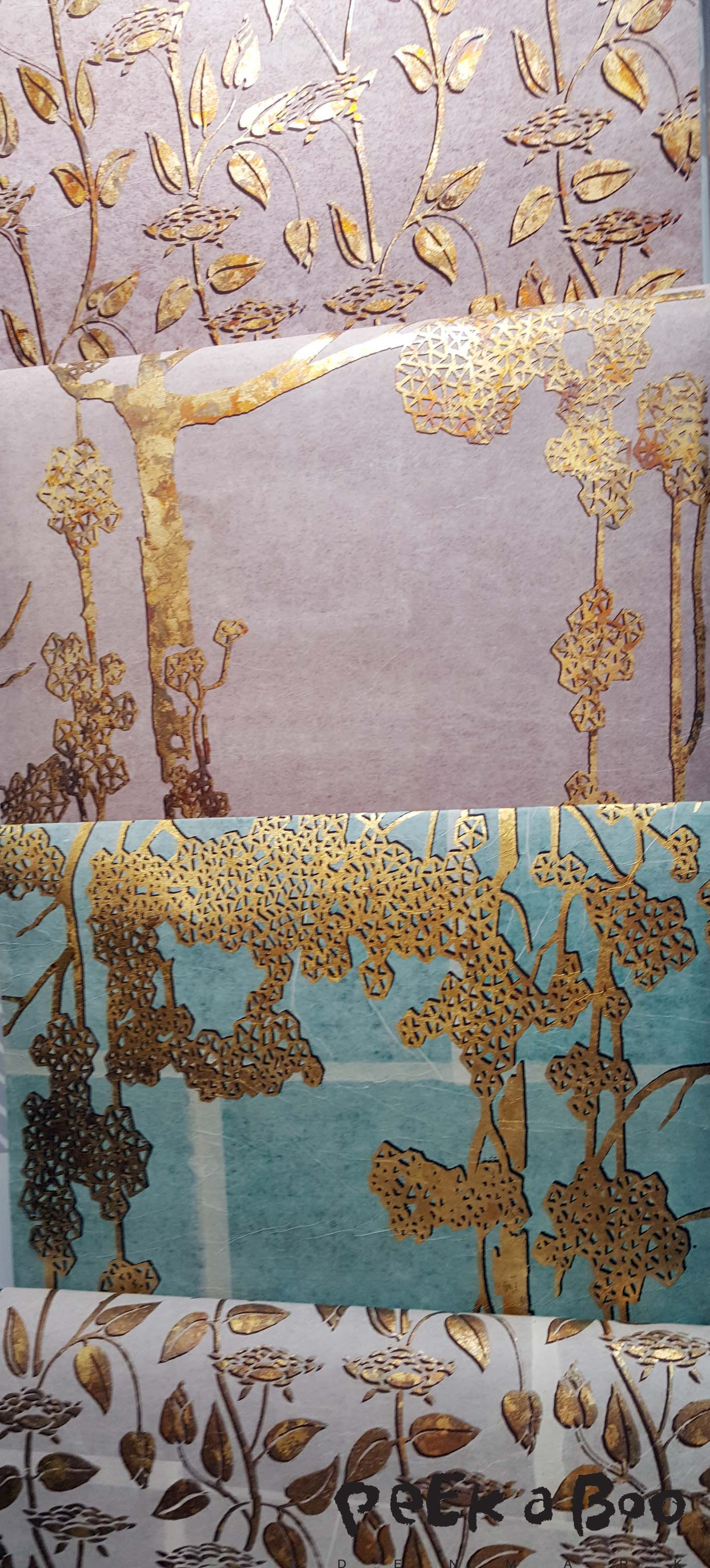 Japanese washi paper from Ikazaki Shachu inc. The gentle feel of the handmade washi paper combined with the innovative design and powerful look of gilding done with gold leaf.