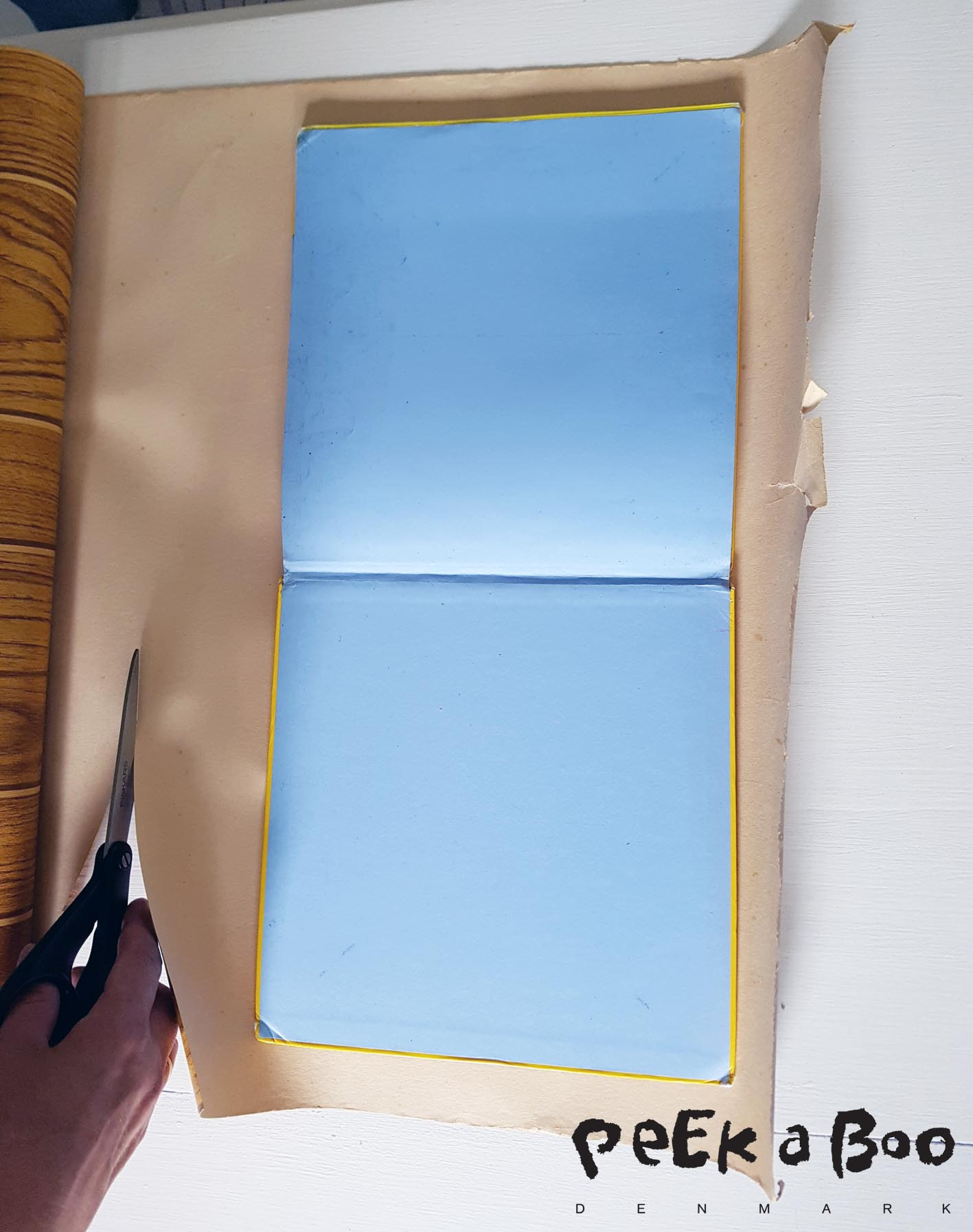 Start by placing your book open on the paper to measure the size of it. You have to make it app. 5-8 cm bigger on all sides.