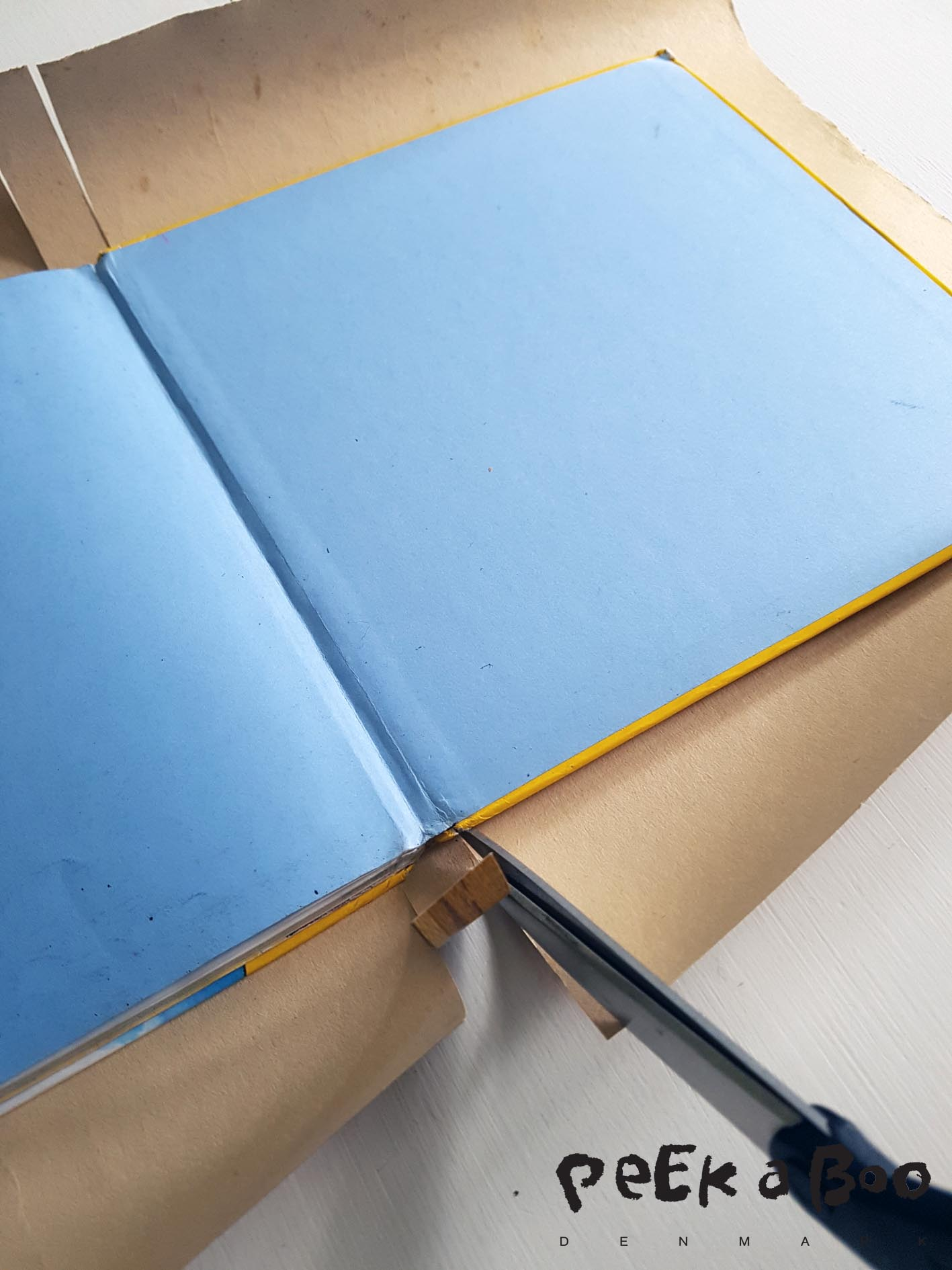 Place the book in the middle and cut slits by the back. Same width as the back of your book.