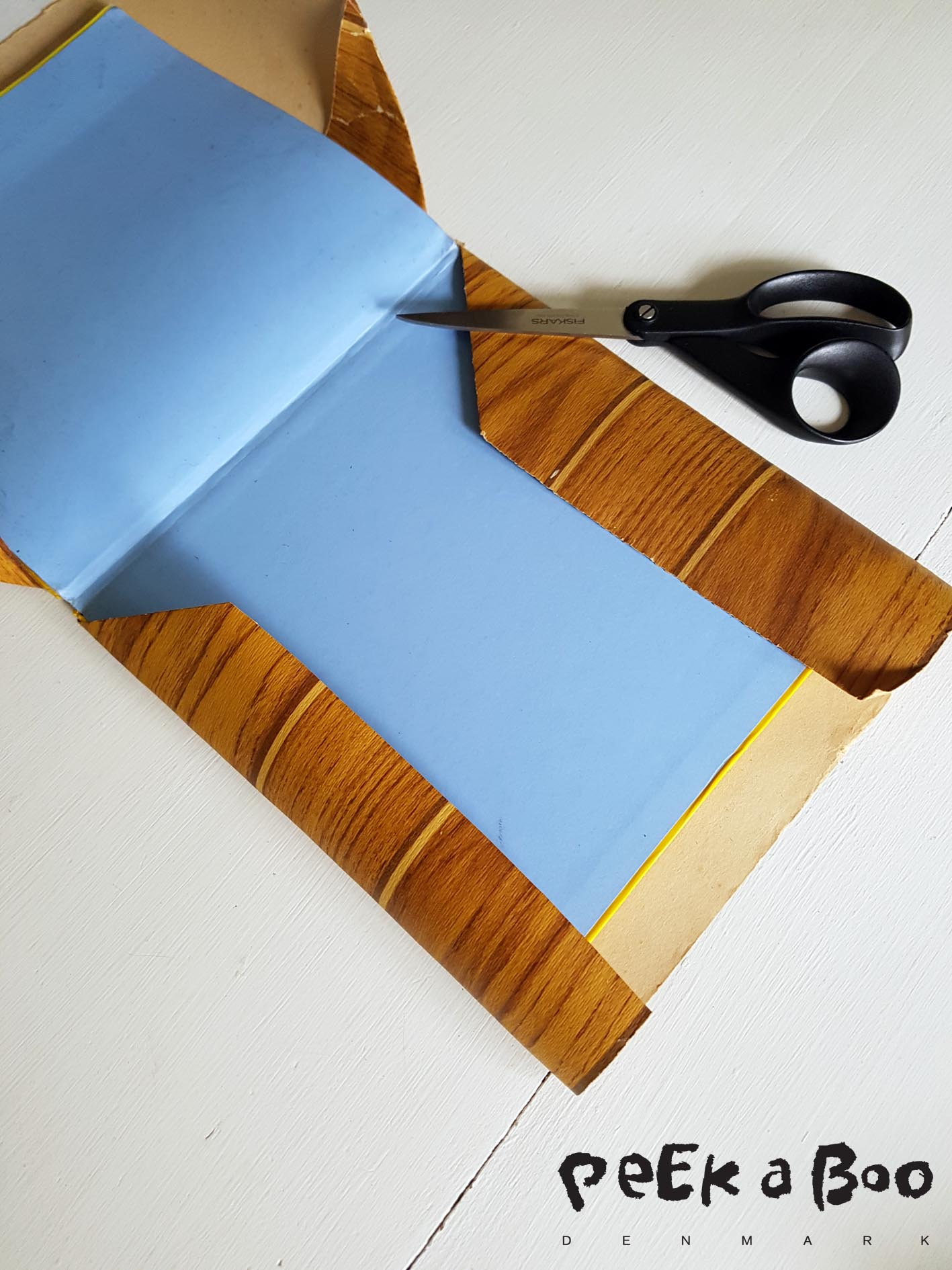 Fold the top and bottom around the book front and back side. like this.