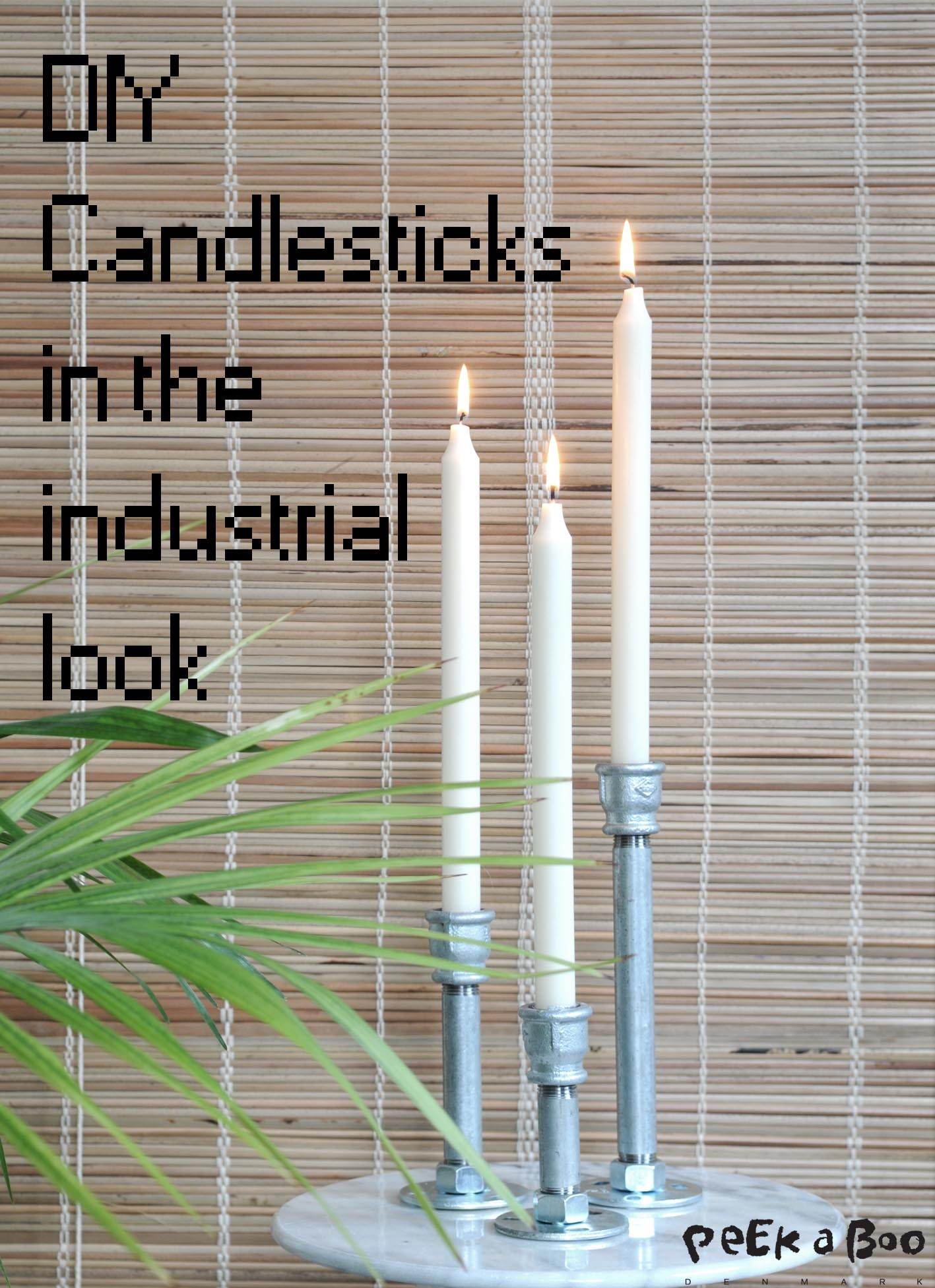 DIY candlesticks made from plumbing pipes.
