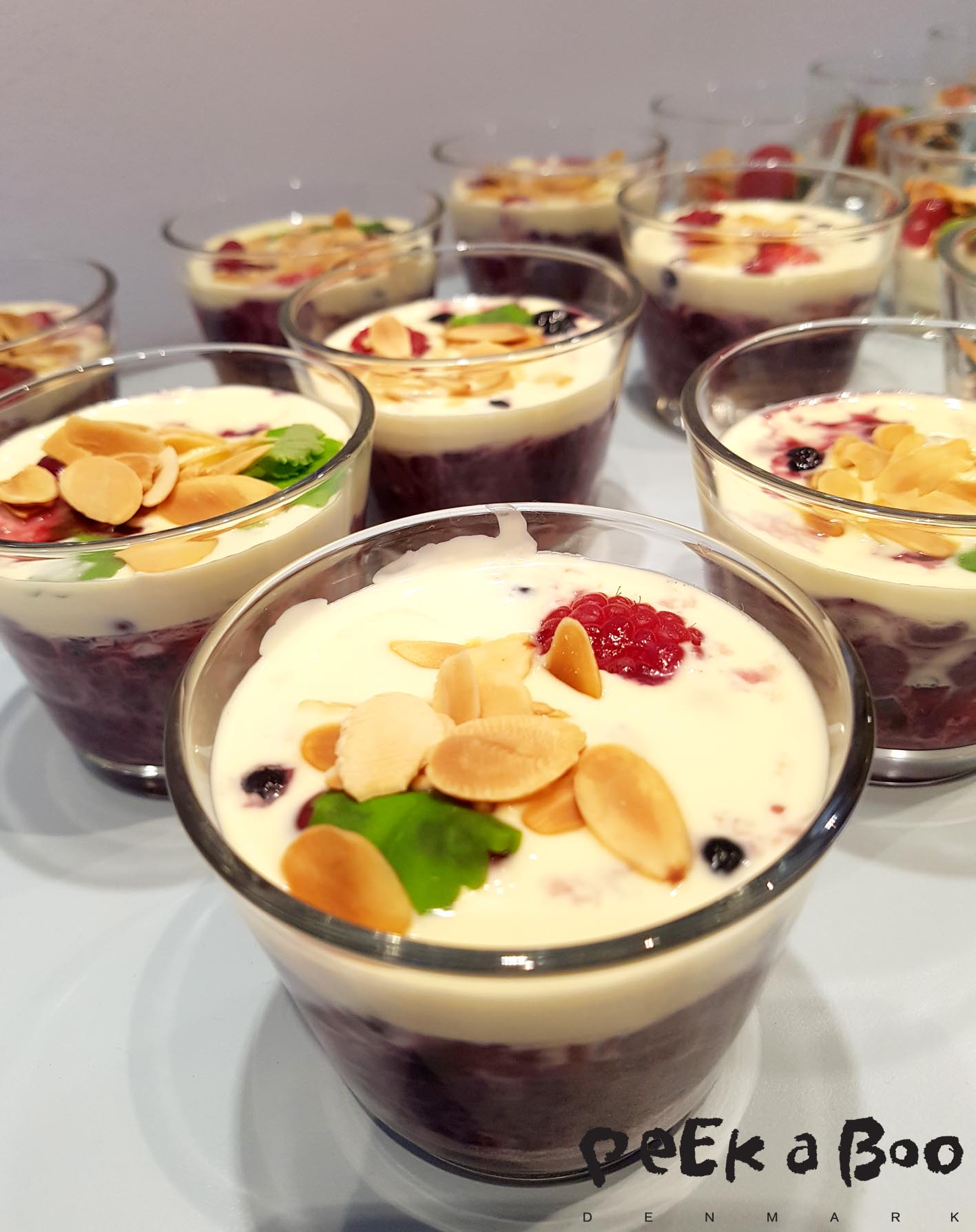 Red porridge with fresh berries, double cream and roasted almonds.