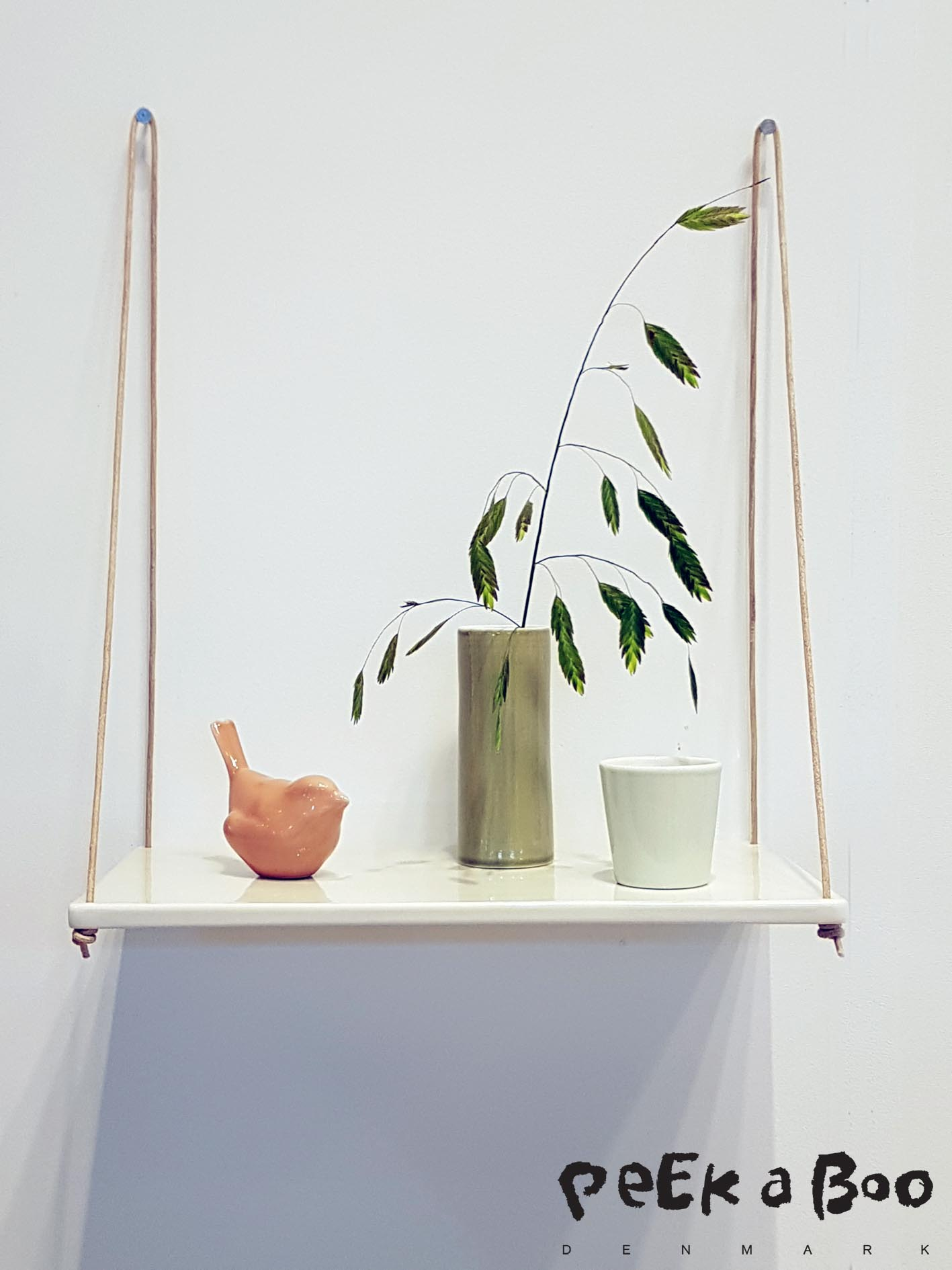 The Danish Ceramic designer Anne Black even made a shelve in ceramic hanging in thin leather straps, really delicate, and very suitable on your bathroom or kitchen where it can resist water. Seen at Northmodern.
