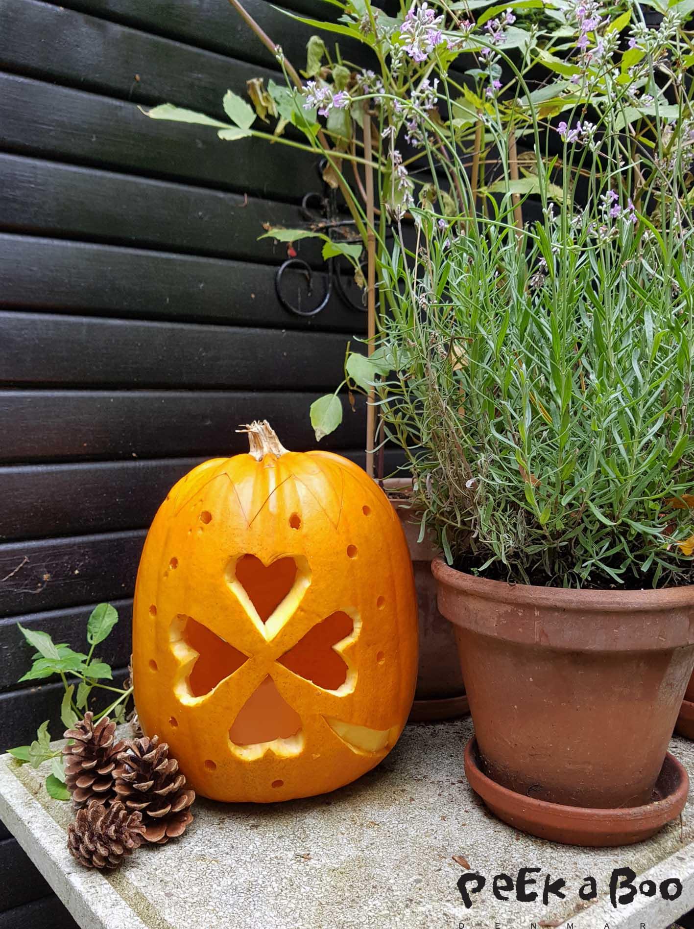 Pumpkin lantern with four-leaf clover pattern.